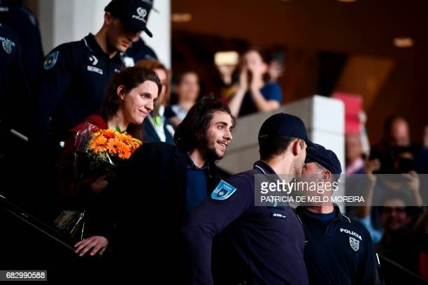 Winner of 2017 Eurovision contest Salvador Sobral accompanied by his sister Luisa Sobral and escorted by policemen looks on upon his arrival at...