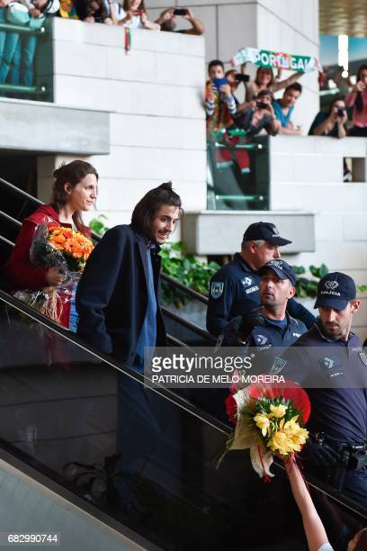 Winner of 2017 Eurovision contest Salvador Sobral accompanied by his sister Luisa Sobral and escorted by policemen looks at fans upon his arrival at...