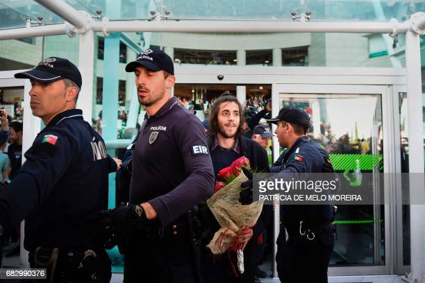 Winner of 2017 Eurovision contest Salvador Sobral , escorted by policemen, looks on upon his arrival at Humberto Delgado Lisbon's airport on May 14,...