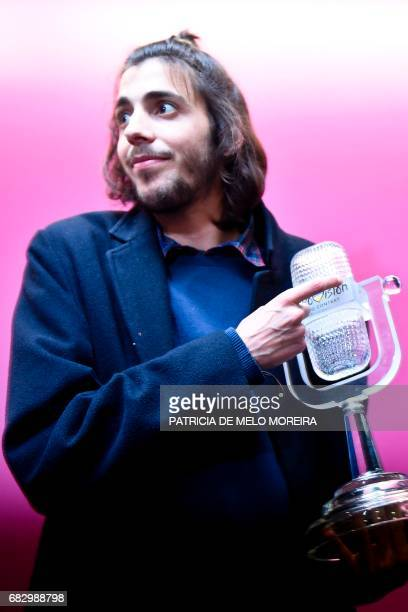 Winner of 2017 Eurovision contest Salvador Sobral poses with his trophy before a press conference upon their arrival at Humberto Delgado Lisbon's...