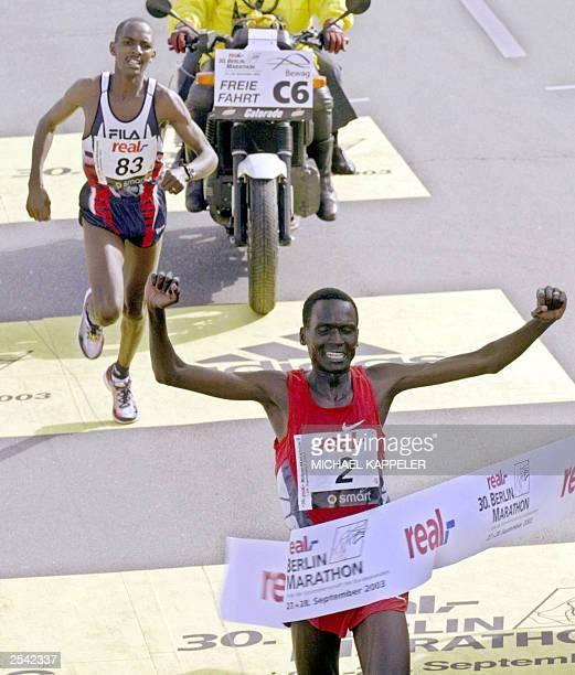 Winner of Berlin Marathon 2003 Paul Tergat from Kenya lifts his arms as he crosses the finishing line before his compatriot Sammy Korir in Berlin 28...