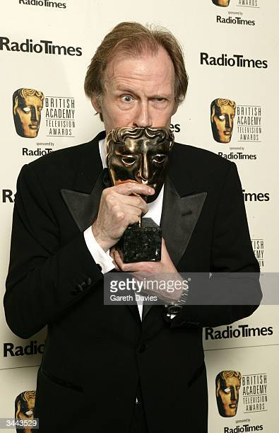 Winner of Best Actor Bill Nighy poses in the pressroom with award for Best Actor following 'The British Academy Television Awards' at the Grosvenor...