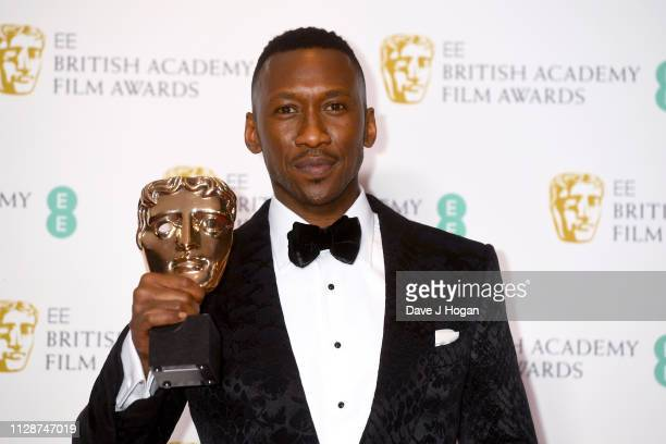 Winner of Best Actor in a Supporting Role Mahershala Ali poses with his award in the press room during the EE British Academy Film Awards at Royal...