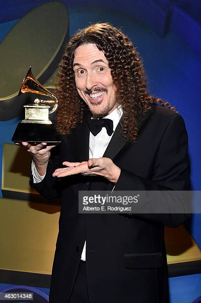 Winner of Best Comedy Album Weird Al Yankovic poses at the Premiere Ceremony during The 57th Annual GRAMMY Awards at Nokia Theatre LA LIVE on...