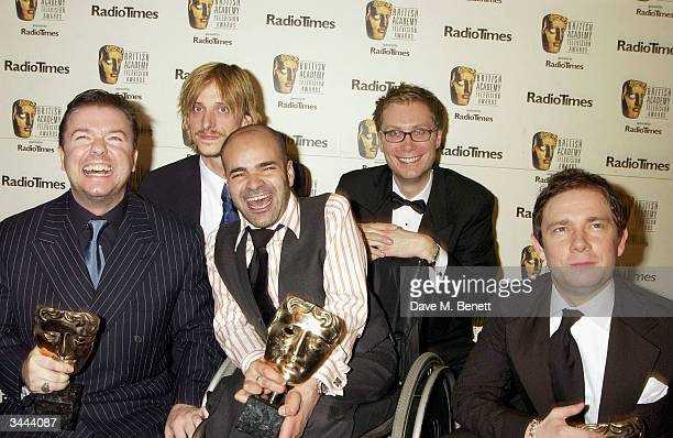 Winner of Best Comedy Performance and Winners of Best Sitcom Ricky Gervais , Mackenzie Crook , Martin Freeman pose with other members of the cast of...