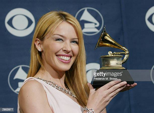 Winner of best Dance Recording Musical Artist Kylie Minogue poses backstage in the Pressroom at the 46th Annual Grammy Awards held on February 8 2004...