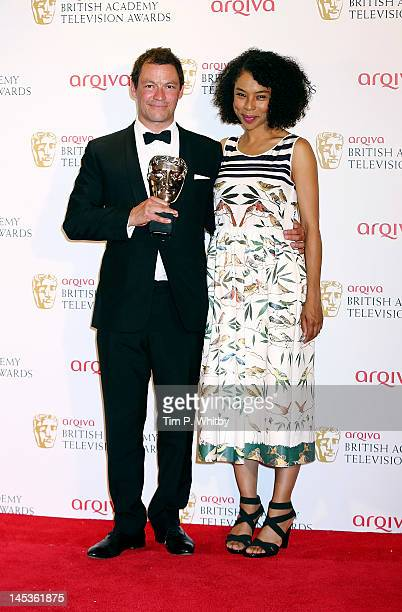 Winner of Best Leading Actor Dominic West poses with presenter Sophie Okonedo in front of the winners boards at The 2012 Arqiva British Academy...
