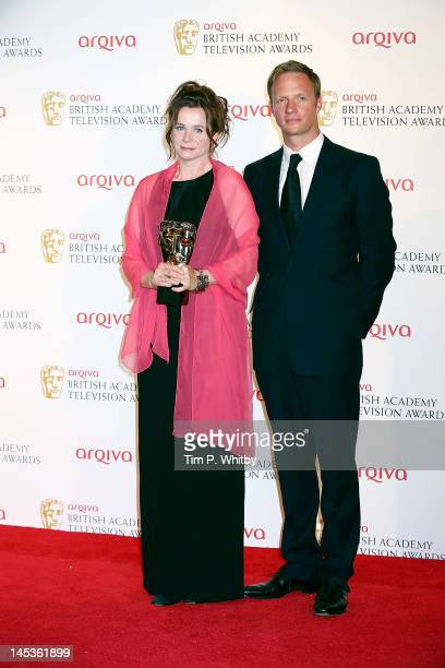 Winner of Best Leading Actress for 'Appropriate Adult' Emily Watson and presenter Rupert Penry Jones poses in front of the winners boards at The 2012...