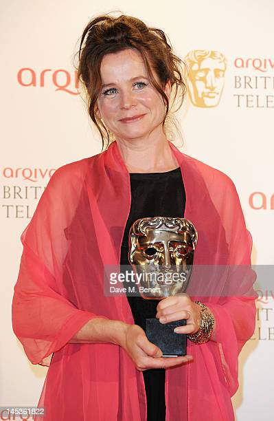 Winner of Best Leading Actress for 'Appropriate Adult' Emily Watson poses in front of the winners boards at the Arqiva British Academy Television...