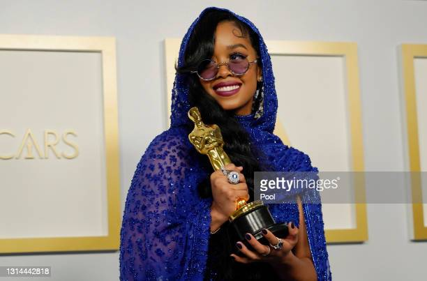 """Winner of Best Original Song for """"Fight For You"""" from """"Judas and the Black Messiah,"""" poses in the press room at the Oscars on Sunday, April 25 at..."""