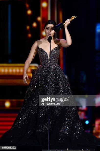 Winner of Best Performance in a Leading Role Female Bollywood actress Alia Bhatt for Udta Punjab accepts her award during 18th International Indian...