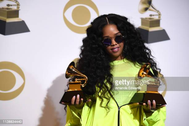 """Winner of Best R&B Performance for """"Best Part"""" and winner of Best R&B Album """"H.E.R."""", poses in the press room during the 61st Annual GRAMMY Awards at..."""