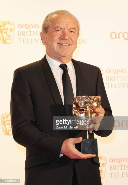 Winner of Best Reality and Constructed Factual for 'The Young Apprentice' Lord Alan Sugar poses in front of the winners boards at the Arqiva British...