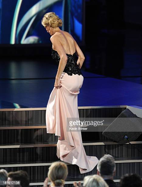 Winner of Best Supporting Actress in a Drama Series Anna Gunn walks onstage during the 65th Annual Primetime Emmy Awards held at Nokia Theatre LA...