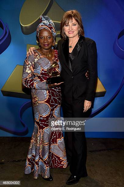 Winner of Best World Music Album Angelique Kidjo and Chair of the National Board of Trustees of the Recording Academy Christine Albert onstage at the...
