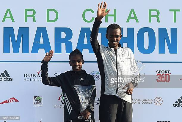 Winner of Elite Men's race Tamirat Tola and winner of Elite Women's race Worknesh Degefa of Ethiopia pose for photos after Standard Chartered Dubai...