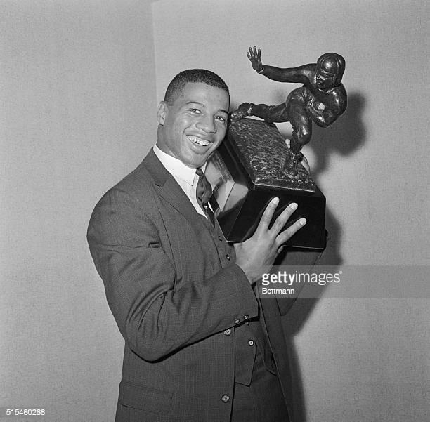 Winner of Heisman Trophy. New York, New York: Syracuse University halfback, Ernie Davis, proudly holds the 1961 Heisman Trophy which he was awarded...