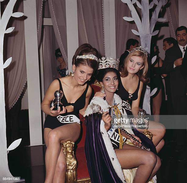Winner of Miss World 1966, Reita Faria of India wears her crown and sits on the winnner's throne with runners up, Nikica Marinovic of Yugoslavia and...