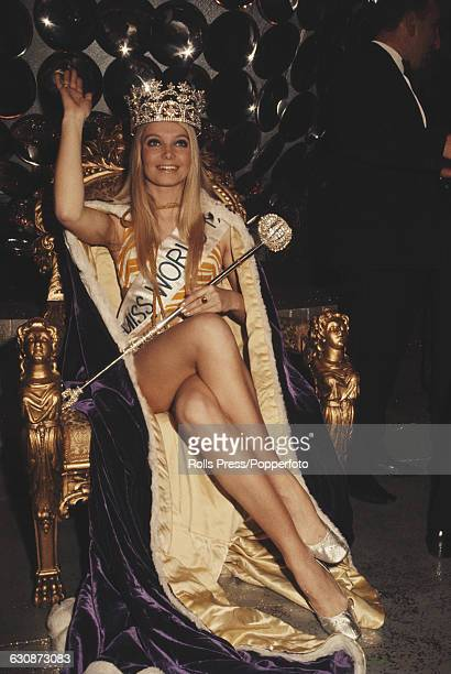 Winner of Miss World 1969 beauty pageant Eva RueberStaier of Austria wears her crown and sits on the winnner's throne at the Royal Albert Hall in...