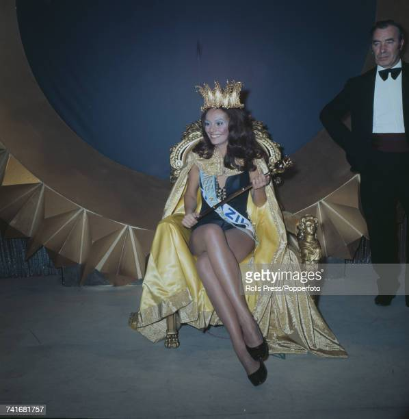 Winner of Miss World 1971 beauty pageant Lucia Petterle of Brazil pictured wearing her crown as she sits on the winnner's throne at the Royal Albert...