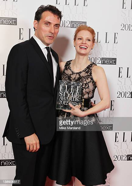 Winner of Next Future Icon Jessica Chastain poses with Rufus Sewell in the press room during the ELLE Style Awards 2012 at The Savoy Hotel on...