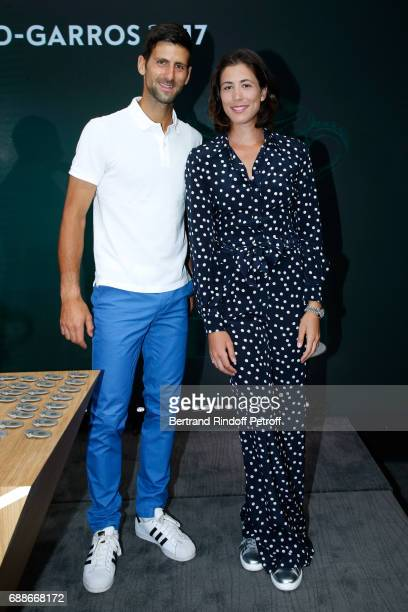 Winner of Roland Garros 2016 Novak Djokovic and Spanish Winner of Roland Garros 2016 Garbine Muguruza attend the 2017 Roland Garros French Tennis...