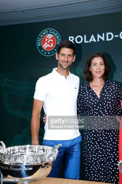Winner of Roland Garros 2016 Novak Djokovic and Spanish Winner of Roland Garros 2016 Garbine Muguruza attend the 2017 Roland Garros French Tennis...
