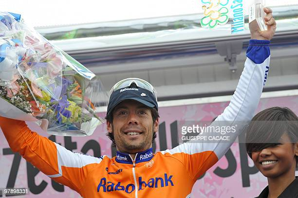 Winner of the 101st Milan SanRemo spring classic Spain's Oscar Freire celebrates on the podium on March 20 2010 in San Remo The 34yearold Spaniard...