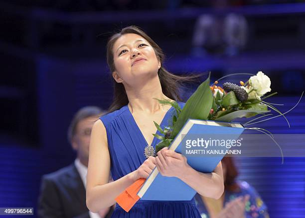 Winner of the 11th International Jean Sibelius Violin Competition US violinist Christel Lee reacts after the announcement of the results during the...