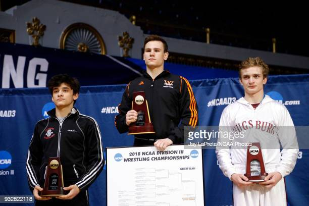 Winner of the 133 weight class Brock Rathbun of Wartburg center is joined on the podium by Sam Bennyhoff of Augsburg right and Troy Stanich of...