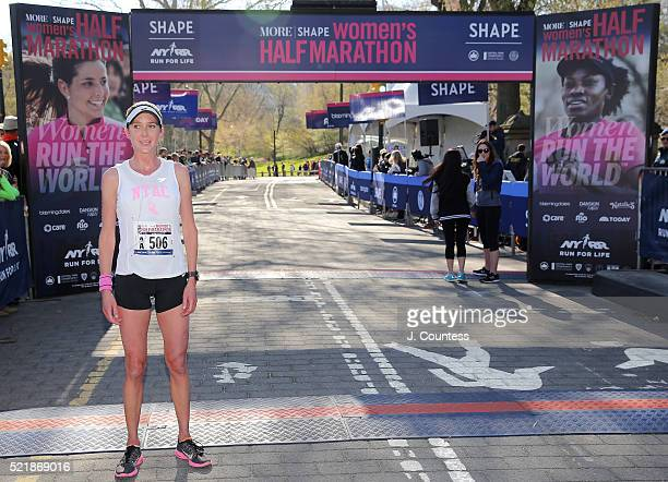 Winner of the 13th Annual MORE/SHAPE Women's HalfMarathon Caroline LeFrak poses for a photo at the finsh line in Central Park on April 17 2016 in New...