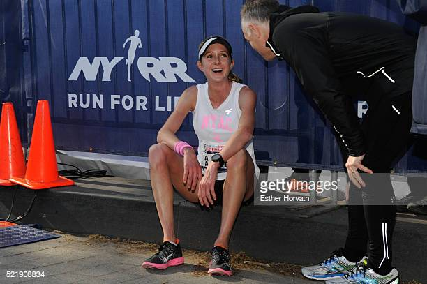 Winner of the 13th Annual MORE/SHAPE Women's HalfMarathon Caroline LeFrak at the finish line at Central Park on April 17 2016 in New York City