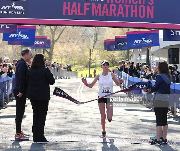 Winner of the 13th Annual MORE/SHAPE Women's HalfMarathon Caroline LeFrak crosses the finsh line in Central Park on April 17 2016 in New York City