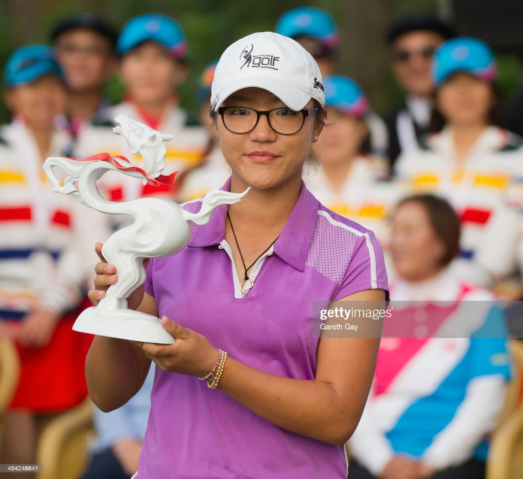 Winner of the 2013 Swinging Skirts World Ladies Masters, Lydia Ko of New Zealand, holds up her trophy, during the last day of the Swinging Skirts 2013 World Ladies Masters, at Miramar Golf & Country Club on December 8, 2013 in Taipei, Taiwan.