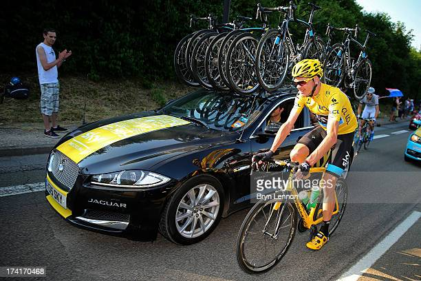 winner of the 2013 Tour de France Chris Froome of Great Britain and SKY smiles as he rides away from the team car after speaking with SKY Procycling...