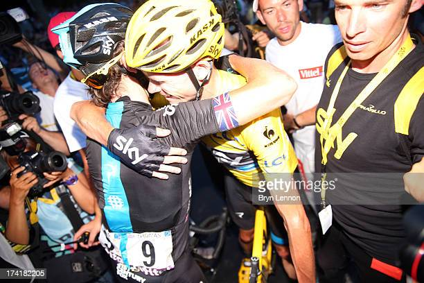 Winner of the 2013 Tour de France Chris Froome of Great Britain and SKY Procycling celebrates with teammate Geraint Thomas of Great Britain after the...