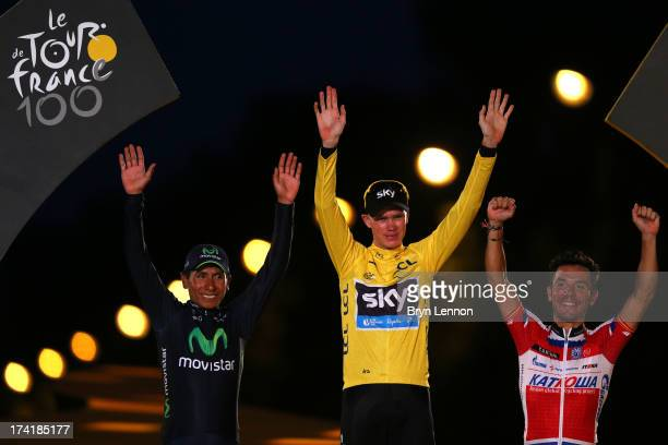 Winner of the 2013 Tour de France, Chris Froome of Great Britain and SKY Procycling celebrates on the podium alongside second placed, best young...