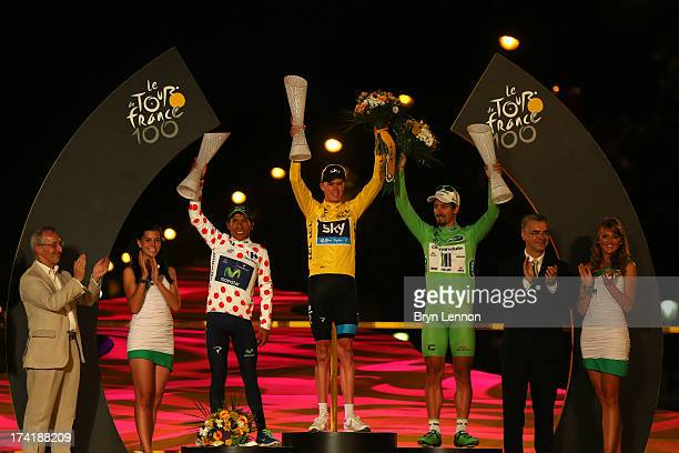 Winner of the 2013 Tour de France, Chris Froome of Great Britain and SKY Procycling celebrates alongside second placed, best young rider and King of...