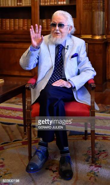 Winner of the 2015 Cervantes literary award Mexican writer Fernando del Paso waves as he poses prior to giving a press conference at the Spanish...