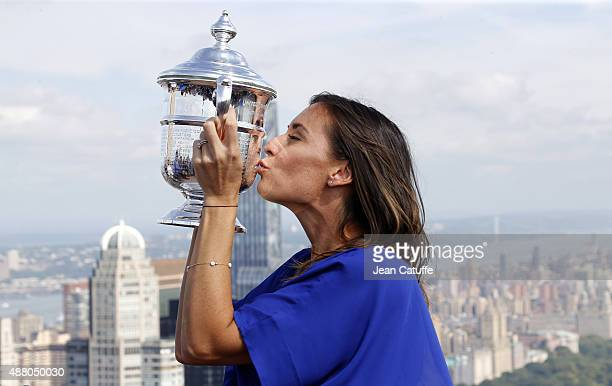 Winner of the 2015 US Open Flavia Pennetta of Italy kisses the trophy on top of Rockefeller Center midtown Manhattan on September 13, 2015 in New...