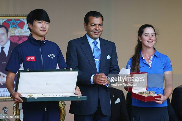 Winner of the 2016 Lalla Meryem Cup Nuria Iturrios of Spain is presented with her trophy by HRH Prince Moulay alongside winner Jeunghun Wang of Korea...