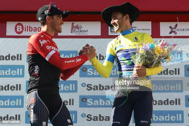 Winner of the 2017 Tour of the Basque country Movistar's Spanish rider Alejandro Valverde shakes hands with second placed Trek's Spanish rider...