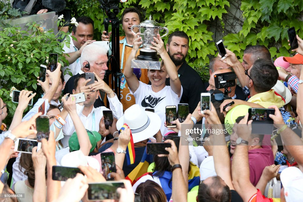 Winner of the 2018 French Open Simona Halep of Romania greets her fans following the French Open final on Day 14 of the 2018 French Open at Roland Garros stadium on June 9, 2018 in Paris, France.