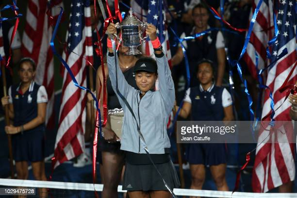 Winner of the 2018 US Open Naomi Osaka of Japan during the trophy ceremony following the women's final against Serena Williams of USA on day 13 of...