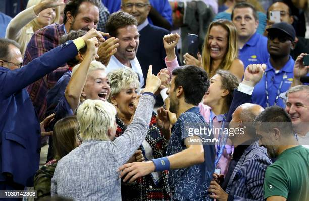 Winner of the 2018 US Open Novak Djokovic of Serbia greets his friend Gerard Butler and his girlfriend Morgan Brown who were in his box following the...