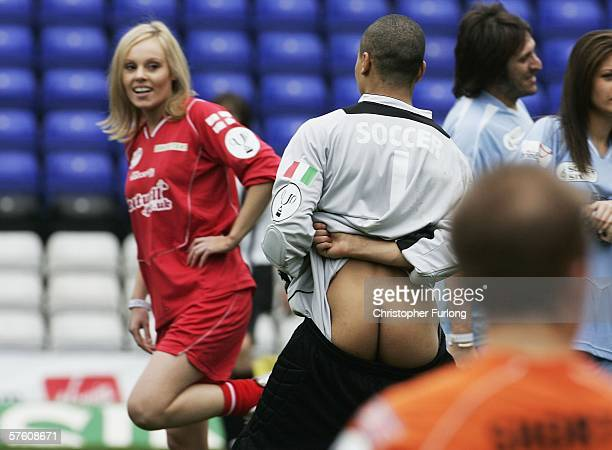 Winner of The Apprentice Michelle Dewberry and part of the England ladies team looks on as Italy goal keeper Luke Bailey entertains the crowd during...