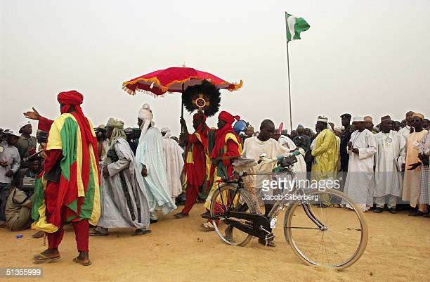 A winner of the Argungu Fishing Festival's donkey race takes home his prize a new bicycle on March 19 in Argungu Nigeria The Argungu Fishing Festival...