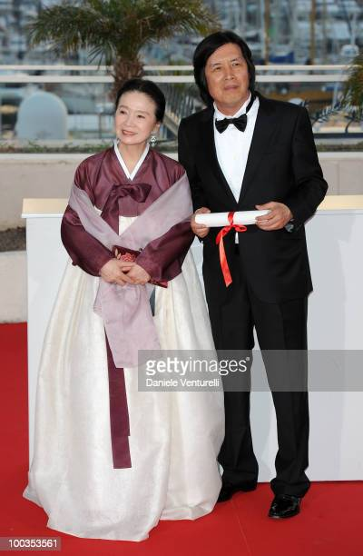 Winner of the award for Best Screenplay actress Yun Jung Hee and director Changdong Lee attends the Palme d'Or Award Ceremony Photo Call held at the...