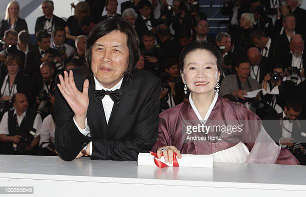 Winner of the award for Best Screenplay Director Changdong Lee and actress Yun Jung Hee attend the Palme d'Or Award Photocall held at the Palais des...