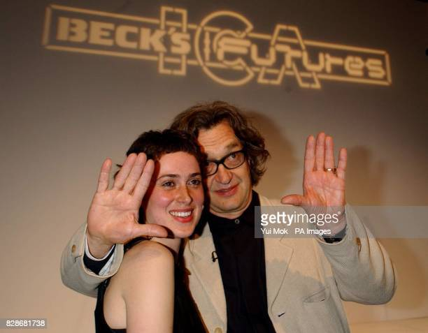 Winner of the Beck's Futures 2003 art prize Rosalind Nashashibi aged 29 with German film director Wim Wenders who presented her with a cheque for 24...